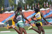 DONETSK, UKRAINE - JULY 13: Tiffany James, Jamaica (right) and Edidiong Ofonime Odiong, Nigeria comp