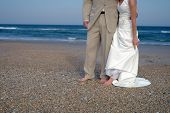 Bride And Groom On The Beach poster