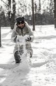 image of ruddy-faced  - Funny teenager girl playing in white snow - JPG
