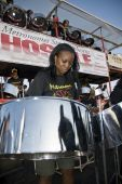 Woman playing steel drums at a steel band festival