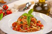 foto of spaghetti  - Whole Wheat Spaghetti with Tomato Sauce  on wooden background - JPG
