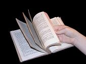 pic of choctaw  - Hand thumbing through a Choctaw Bible on black - JPG