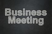 Finance concept: Business Meeting on chalkboard background