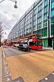 British icons double decker bus and taxi along Oxford Street in London, UK