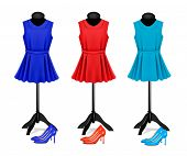 Fashion boutique background with colorful dresses and shoes.