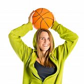 Blonde Girl Playing Basketball Over White Background