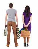 couple with shopping bag. rear view. Isolated over white.
