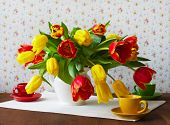 Still life with red and yellow tulips