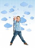 Kid Doing Victory Gesture Over Clouds Background