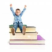 Kids On Several Books Isolated Over White Background