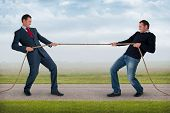 stock photo of tug-of-war  - tug of war work life balance conflict concept - JPG