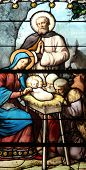 PARIS, FRANCE - NOV 11, 2012: Nativity Scene, stained glass, stained glass.The Church of St Severin