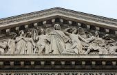 PARIS, FRANCE - NOV 09, 2012: The sculpted tympanum of Eglise de la Madeleine. Madeleine Church was