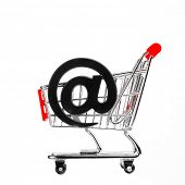 online shopping concept - shopping cart with email symbol, isolated on white