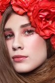 Close-up portrait of young beautiful fresh girl with long hair and floral headband