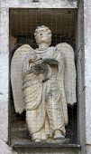 PARMA, ITALY - MAY 01, 2014: Angel, marble statue on the baptistry from Benedetto Antelami. Baptistery in Parma is considered to be among the most important Medieval monuments in Europe.