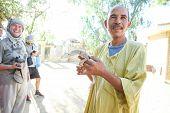 Man Holding Desert Monitor In Tozeur Zoo