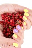 Female hands with stylish colorful nails holding ripe berries, isolated on white