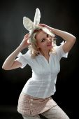 stock photo of easter bunnies  - Blond girl with rabbit - JPG