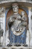 PARMA, ITALY - MAY 01, 2014: Virgin Mary with baby Jesus on the baptistery from Benedetto Antelami.