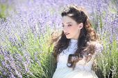 Beautiful Young Girl Outdoors in a Lavender Flower Field