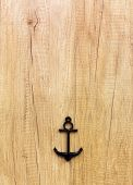 Anchor decor on the wooden background