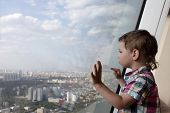 picture of penthouse  - The kid looking at Moscow from penthouse