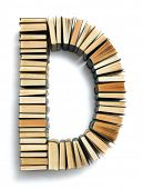 Letter D formed from the page ends of closed vintage hardcover books standing on a white background