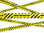 Under construction concept background - yellow warning caution ribbon tape on white background