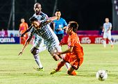 Sisaket Thailand-july 6: Nuttawut Khamrin Of Sisaket Fc. (orange) In Action During Thai Premier Leag