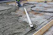 stock photo of reinforcing  - Roadwork mesh reinforcement for concrete slab at road upgrade - JPG