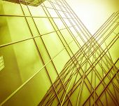 Panoramic and perspective wide angle view to steel light yellow background of glass high rise buildi