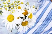 Beautiful bouquet of daisies on wooden background