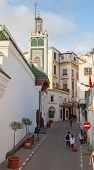 Tangier, Morocco - March 22, 2014: Old Medina Area In Tangier, Morocco. People Are Walking On Narrow