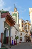 Tangier, Morocco - March 22, 2014: Street View Of Old Medina Area In Tangier, Morocco. Arabic Women