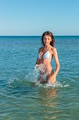 seductive woman wear fashionable swimwear, tanning girl near ocean, tropical resort, summer holiday