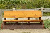 Cedar Wooden Park Bench On The Beach