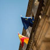 Spanish Flag And European Union Flag Seen From Below