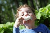 Boy Eating Ice Cream Outdoor