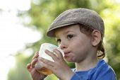 Kid With Cup Of Tea