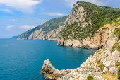 coastal landscape with blue sea and beautiful cliffs an mountains