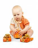 Cute baby keeps colorful gift box