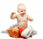 Happy baby with christmas silver tinsel
