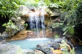 Little pool with a waterfall and hot thermal water, Costa Rica