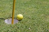 Golf Ball Near The Hole With Copy Space
