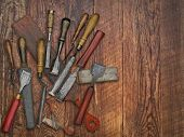 set of vintage chisels and sharpening stones, strop over wooden bench, space for your text