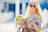 The blonde woman with bouquet of flowers