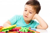 Boy Is Playing With Building Blocks