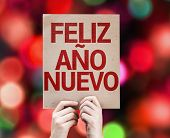 Happy New Year (in Spanish) card with colorful background with defocused lights