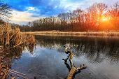 Sunset scene on lake in autumn time